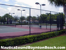 view of the lighted tennis courts